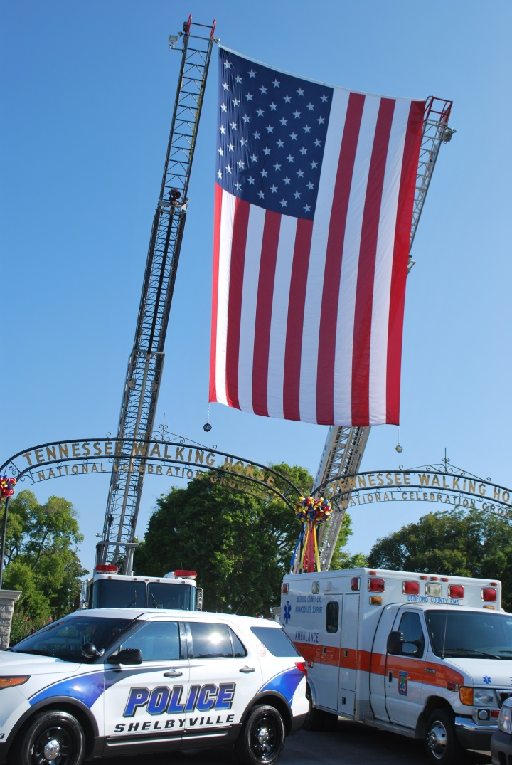 Photo by Jason Reynolds Bedford County and Shelbyvile (Tenn.) emergency responders set up their annual 9/11 display on Friday, Sept. 11, 2015.