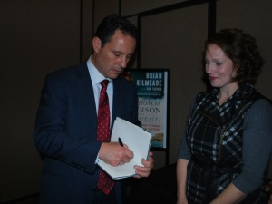 Photo by Jason Reynolds Brian Kilmeade autographs a book for Kari Moore, director of the USO Fort Campbell.